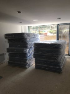 stack of new mattresses