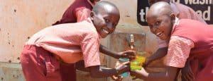 Ung'atani-Primary-School-children-with-safe-water,-Kenya