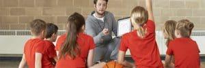 Coach-Giving-Team-Talk-To-Children-Basketball