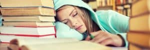student-sleeping-in-library