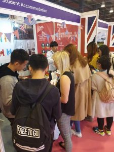 students at host stand China Education Expo CEE