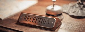 Focus-Photo-of-Reception-Signage