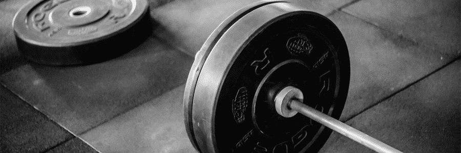 Grayscale-Photo-of-Black-Adjustable-Barbell