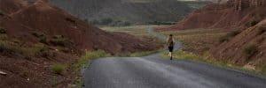 Woman-Jogging-in-Scenic-Road