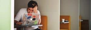Man-looking-stressed-Using-Macbook-Pro
