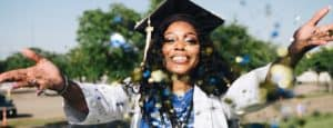 woman-throwing-confetti-with-graduation-cap