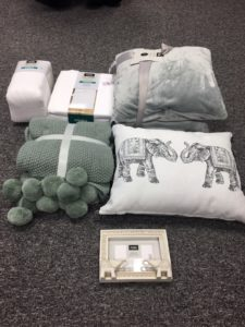 white bedding and green accessories for student room