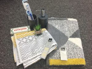 yellow and grey bathroom accessories for student room