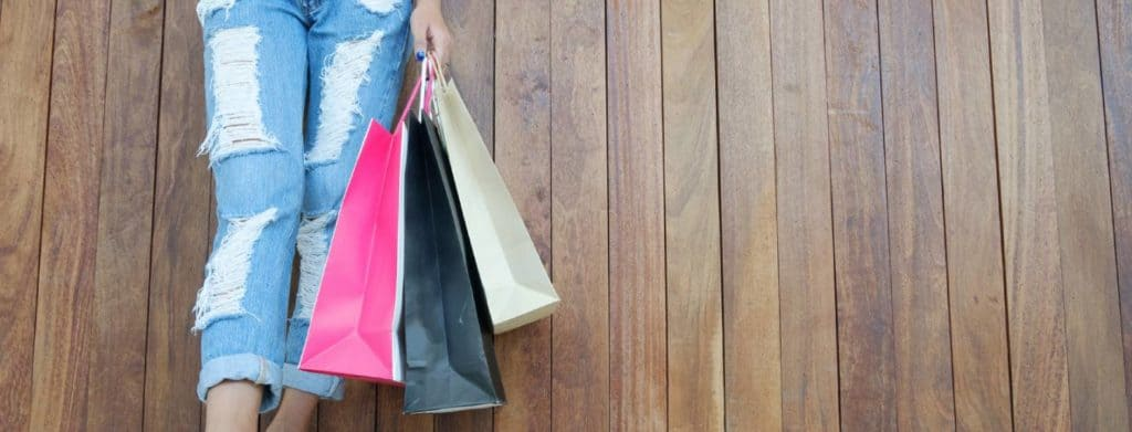 woman holding shopping bags after getting student discounts