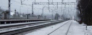 christmas travel snow on train tracks