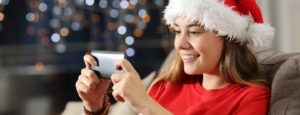 lonely student at christmas on video call with family