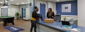 student chatting to accommodation staff