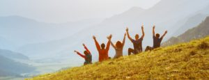 group of students outside on hillside happiness