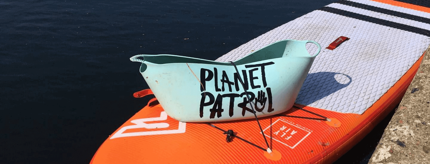 Planet Patrol collector on paddleboard