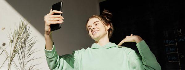 girl-holding-phone-doing-tiktok-video