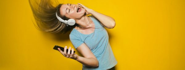 woman-listening-to-music-and-dancing