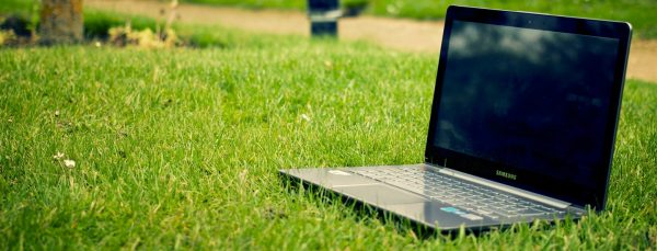 virtual-events-on-laptop-on-grass