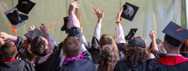 people-graduating-with-hats-in-air