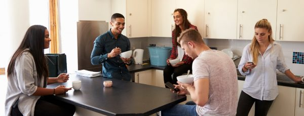 students laughing in accommodation uni mental health day