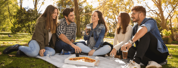 Roadmap to your social life students meeting in a park for pizza and a drink